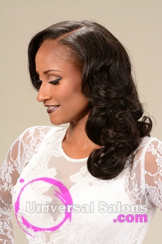 Left Side View of a Long Hairstyle for Black Women with Soft Curls from Marcus Doss