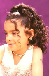Left View: Cascading curls Ponytail Black Hairstyles for Little Girls