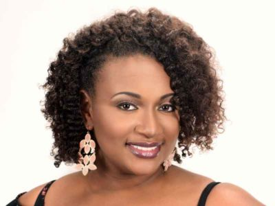 Natural Hairstyle with Tight Curls from Kenya Young