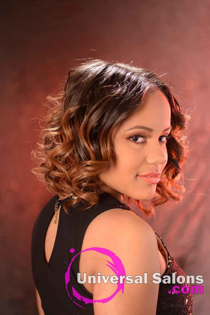 Back Right View: Medium Length Curly Bob Hairstyle with Highlights