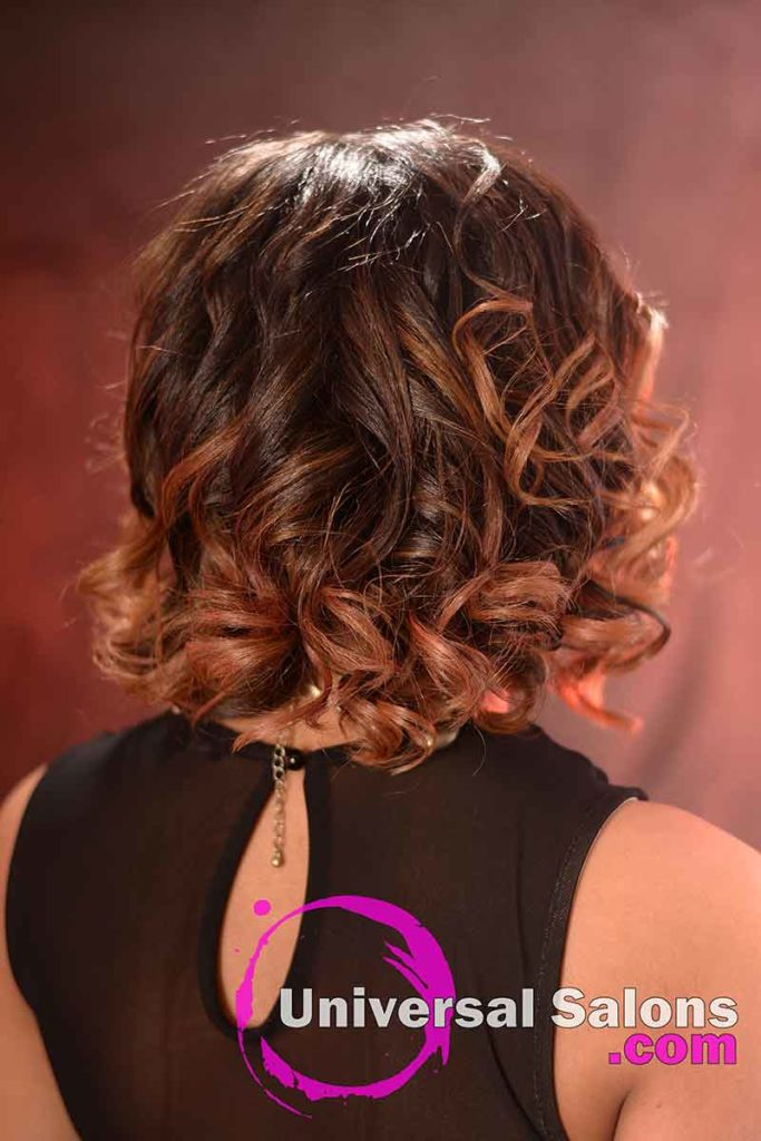 Back View: Medium Length Curly Bob Hairstyle with Highlights