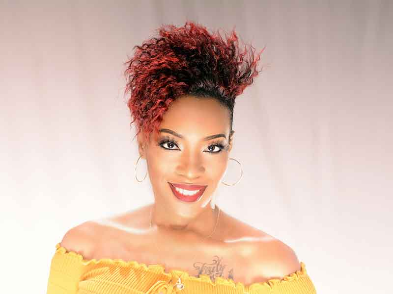 Short Twist and Let Out Hairstyle with Red Hair Color