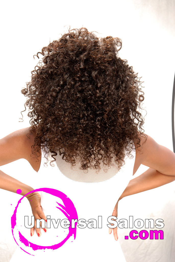 Back: Natural Tight Curly Hairstyle from Marcus Doss in Fayetteville, NC