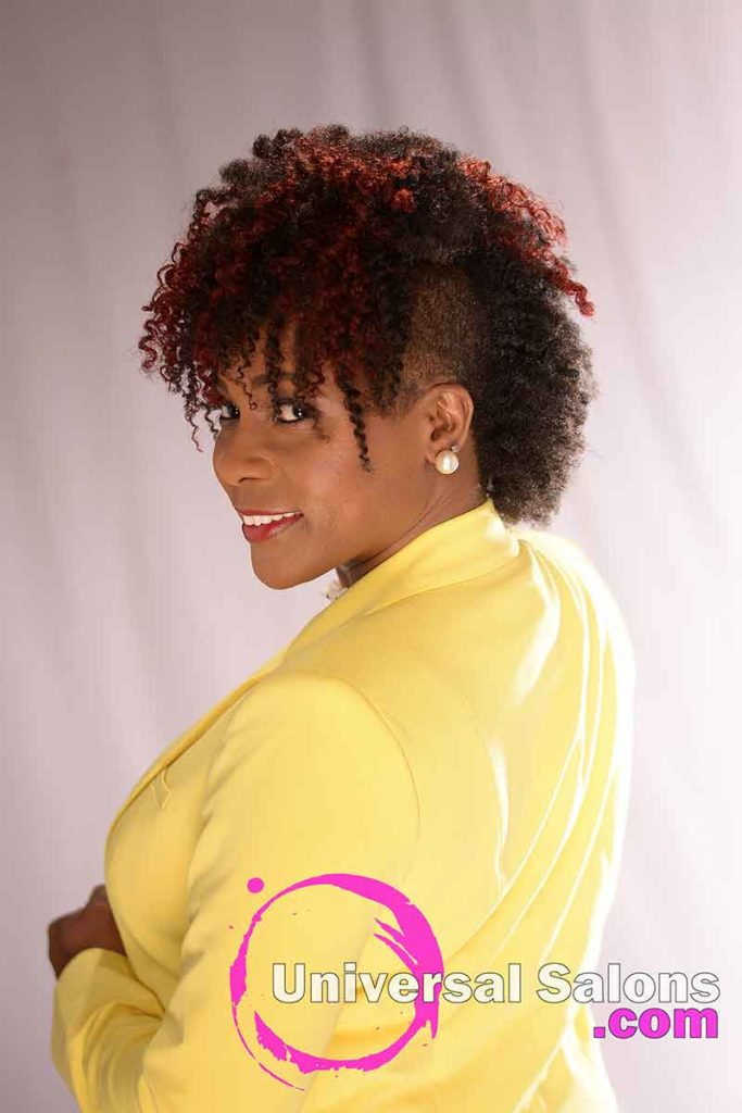 The Left Side View of a Curly Mohawk hairstyle for black Women from Nivi Grimball