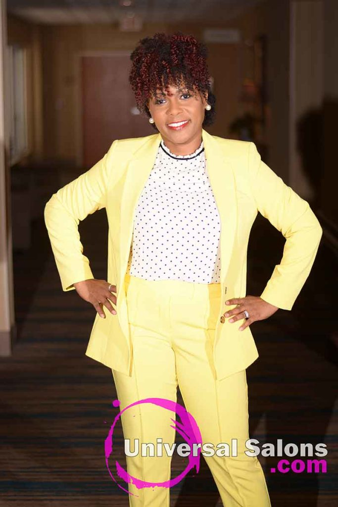 Standing Model in Professional Attire with a Mohawk Hairstyle for Black Women from Nivi Grimball
