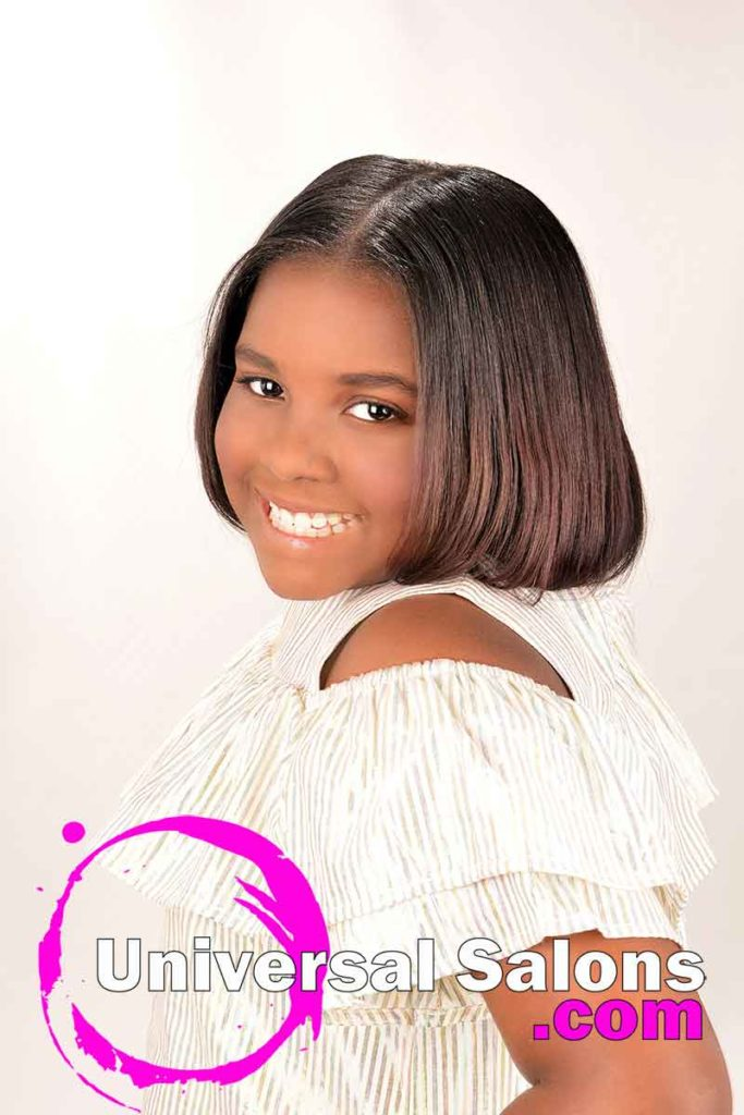 Left View Little Girl Wearing Silk Press Natural Hairstyle