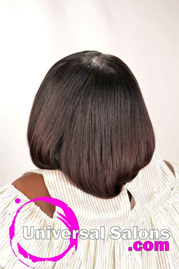 Back View Little Girl Wearing Silk Press Natural Hairstyle