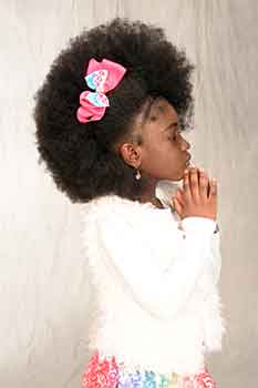 Classic Afro With a Braid in Front Black Hairstyles for Little Girls