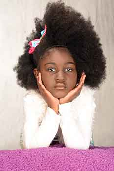 Model With Hands on Face: Classic Afro With a Braid in Front Black Hairstyles for Little Girls