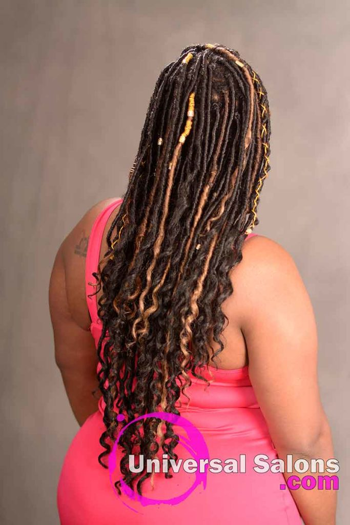 Back View: Model Wearing Long Goddess Locks Hairstyle With Accents