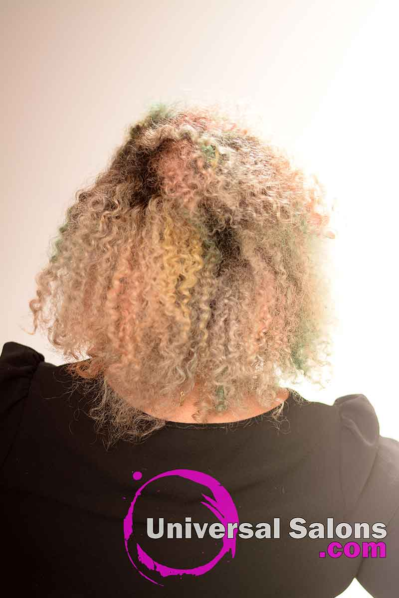 The Back View of a Natural Braid Out Hairstyle with Vivid Hair Color
