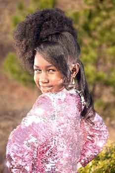 Silk Press Bang With an Afro Ponnytail Hairstyle