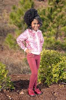 Model in the Woods: Silk Press Bang With an Afro Ponnytail Hairstyle