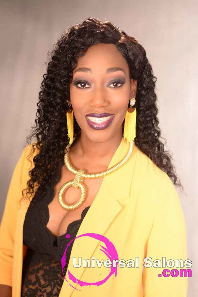 Long Curly Sew-In Hairstyle for Black Women With Gold Necklace