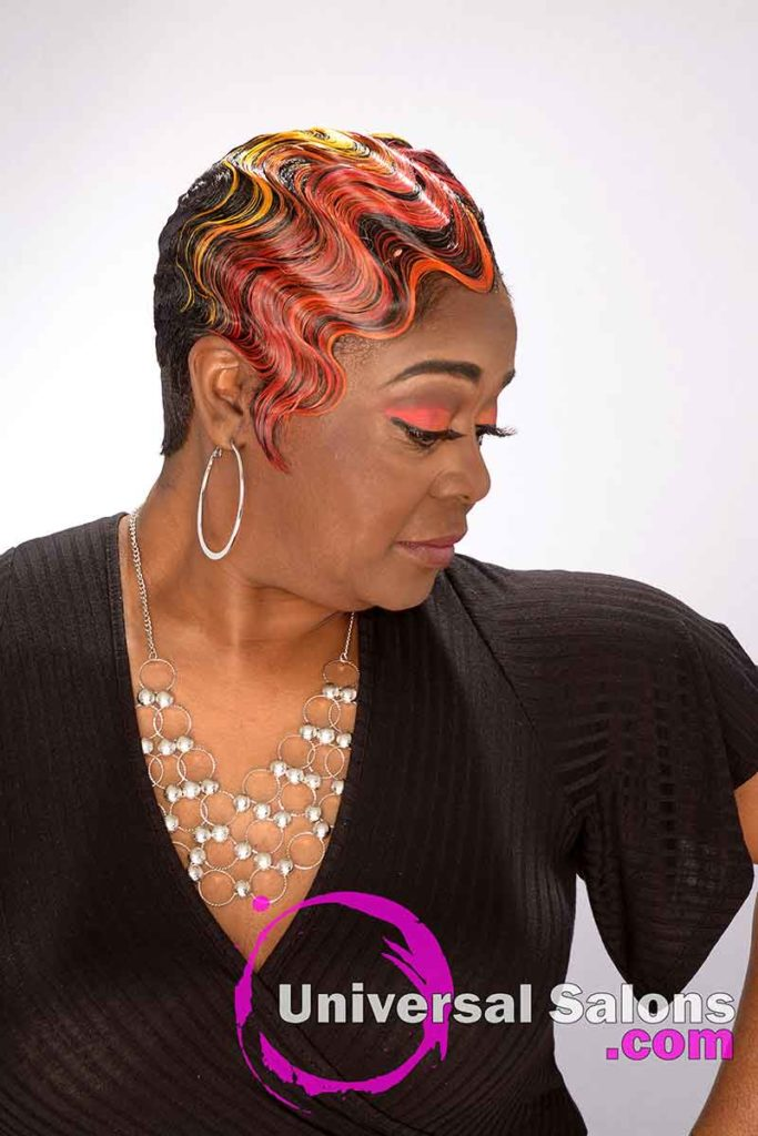 Mode Looking Down With Red Hair Color on Short Finger Waves