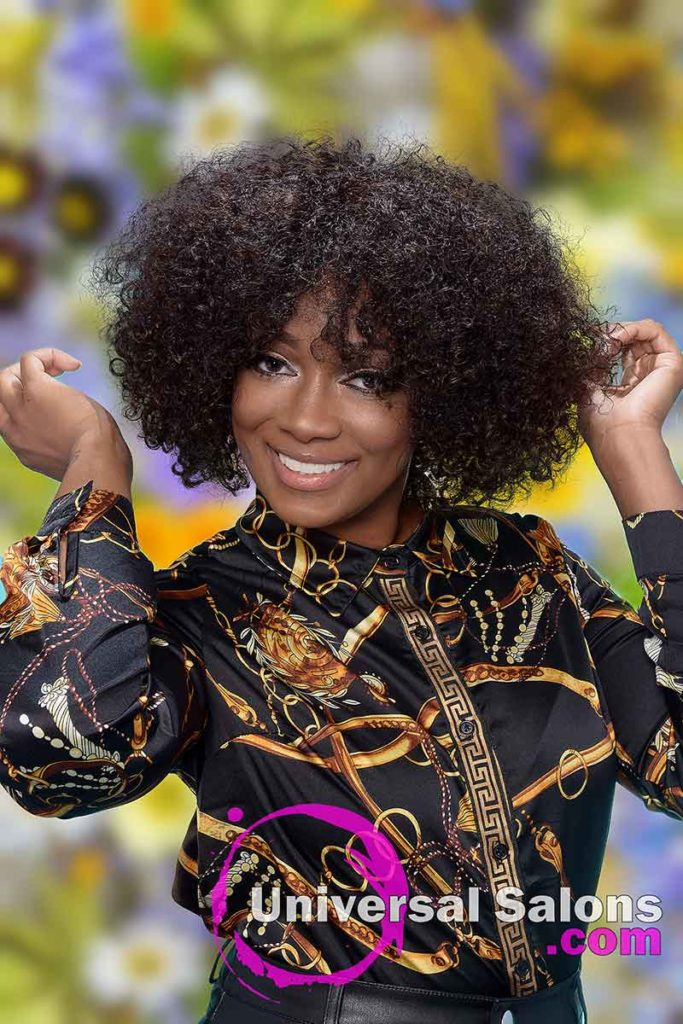 Curly Sew-in Hairstyle Model With Hands in the Hair