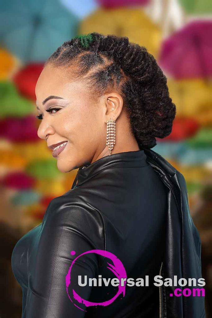 Model Looking Over Shoulder With Barrel Twist Locs Hairstyle