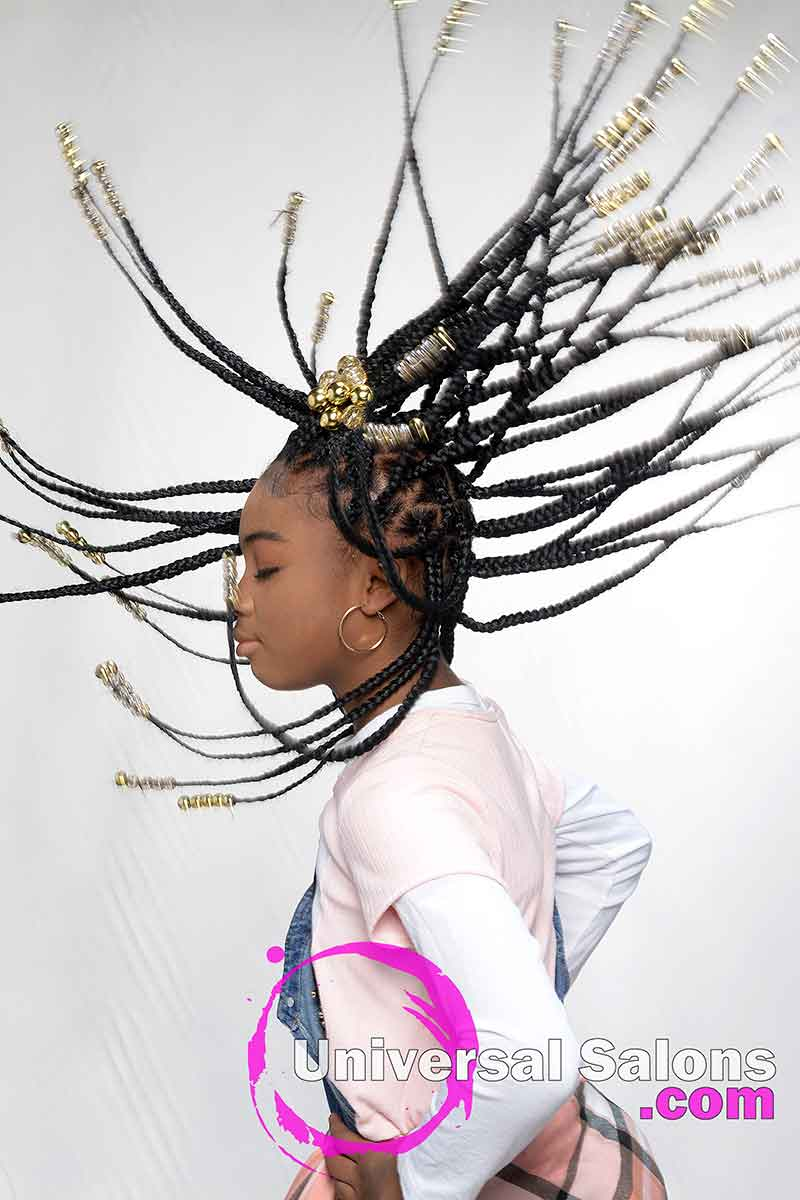 Model Flipping Her Braids Hairstyle