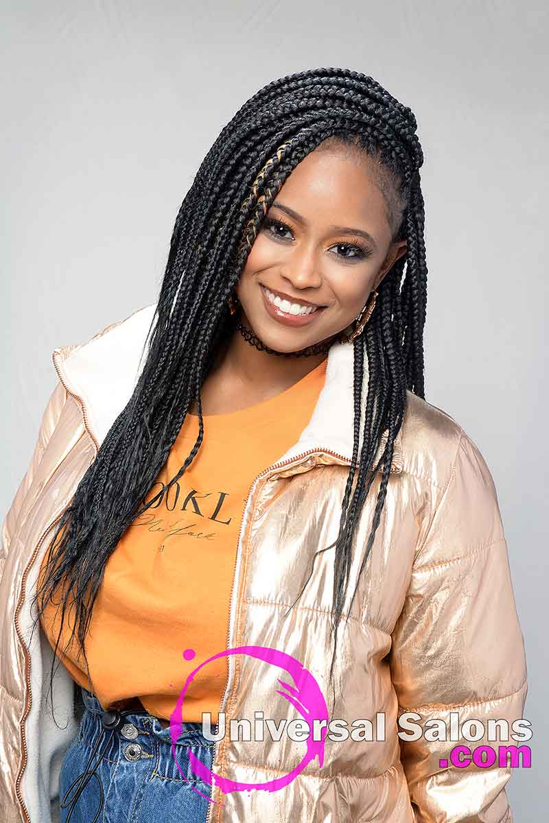 Model Smiling With Long Knotless Box Braids