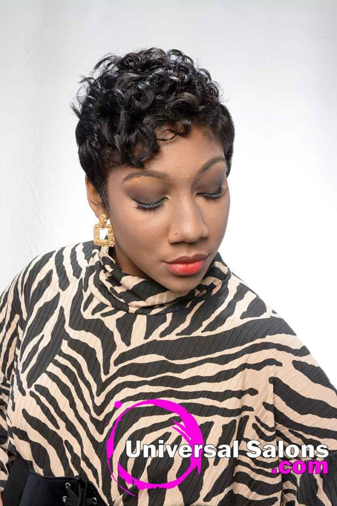 Model Looking Down With Short Curly Black Hairstyle