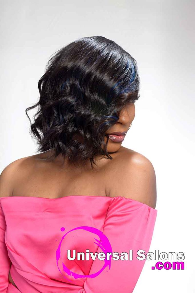 Model Looking Down With Razor Cut Quick Weave Bob